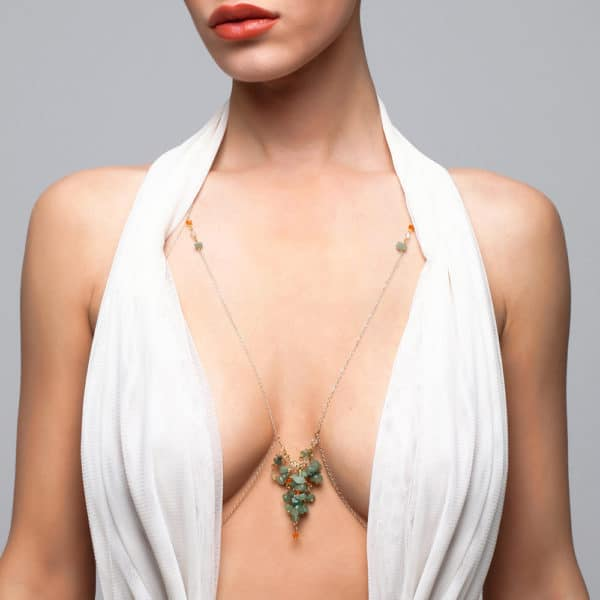 Gold body jewelry and jade stones falling between the breasts and bare back FUNGI at Brigade Mondaine
